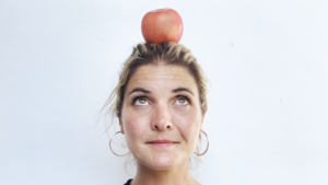 Abbey with an apple perched on top of her head