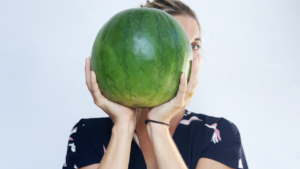 Abbey holding up a large watermelon